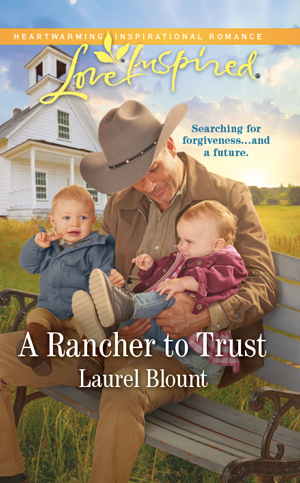 Rancher with twin toddlers on his lap - book cover of A Rancher to Trust by Love Inspired author Laurel Blount